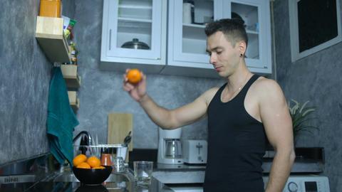 Man gets mandarin juice and drinking that seamless loop Footage