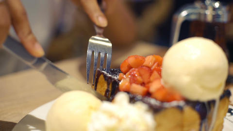 Chocolate toast with strawberry in cafe close-up Footage
