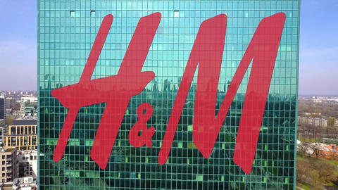 Aerial shot of office skyscraper with H M logo. Modern office building Live Action