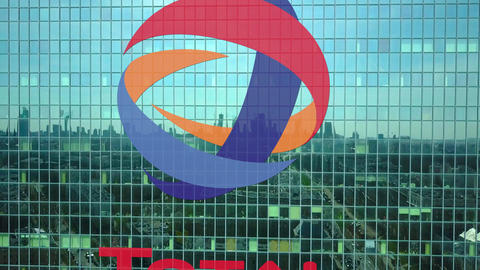 Aerial shot of office skyscraper with Total S.A. logo. Modern office building Footage