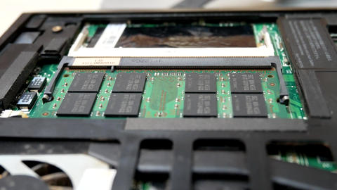 Hands takes ram memory dimm in notebook Footage