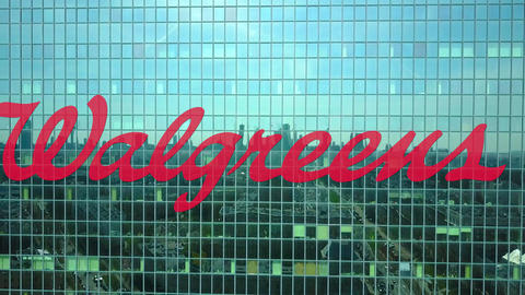 Aerial shot of office skyscraper with Walgreens logo. Modern office building Footage