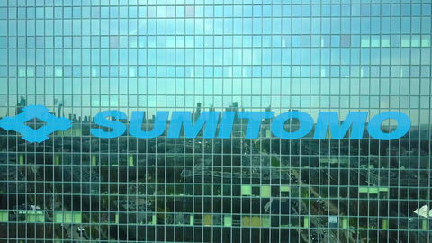 Aerial shot of office skyscraper with Sumitomo Corporation logo. Modern office Live Action