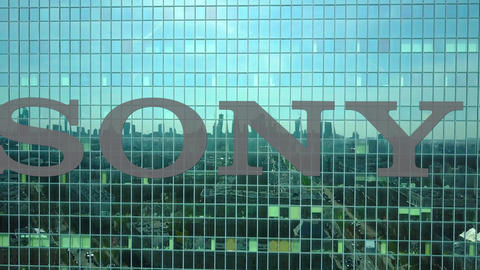 Aerial shot of office skyscraper with Sony Corporation logo. Modern office Live Action