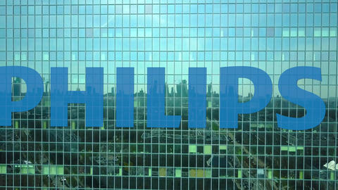 Aerial shot of office skyscraper with Philips logo. Modern office building Footage