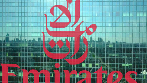 Aerial shot of office skyscraper with Emirates Airline logo. Modern office Live Action
