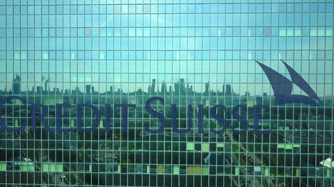Aerial shot of office skyscraper with Credit Suisse Group logo. Modern office Footage