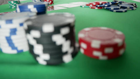 Poker Player Moves Casino Chips on Table Filmmaterial