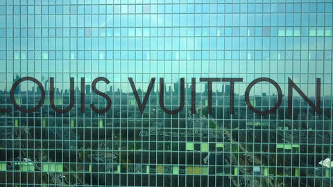 Aerial shot of office skyscraper with Louis Vuitton logo. Modern office building Footage