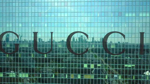 Aerial shot of office skyscraper with Gucci logo. Modern office building Footage