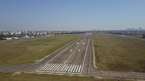 City airport plated runway and taxiing aircraft on a sunny day Footage