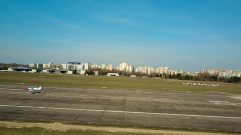 WARSAW, POLAND - APRIL, 1, 2017. Aerial shot of a blue propeller airplane Footage
