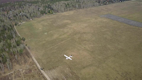 Small propeller aircraft flying near city airport runway Footage