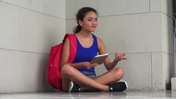 Confused Female College Student With Tablet Live Action