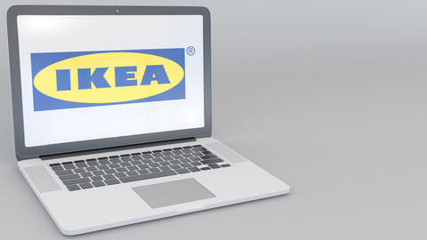 Opening and closing laptop with Ikea logo on the screen. Computer technology Footage