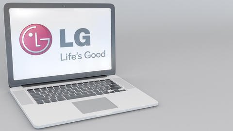 Opening and closing laptop with LG Corporation logo on the screen. Computer Footage