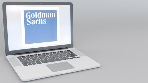 Opening and closing laptop with The Goldman Sachs Group, Inc. logo on the screen Footage