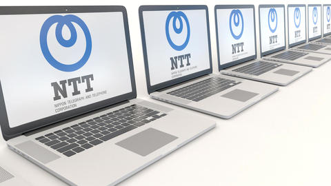 Modern laptops with Nippon Telegraph and Telephone Corporation NTT logo Footage