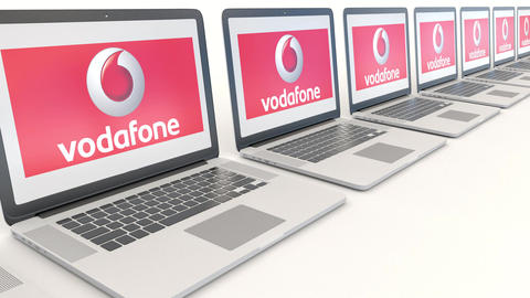 Modern laptops with Vodafone logo. Computer technology conceptual editorial 4K Footage