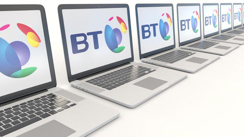 Modern laptops with BT Group logo. Computer technology conceptual editorial 4K Footage