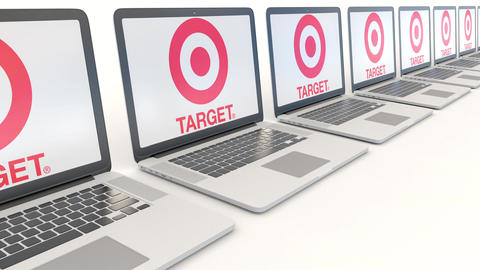 Modern laptops with Target Corporation logo. Computer technology conceptual Footage