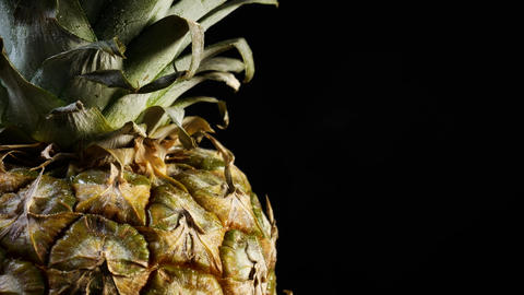 Fresh pineapple rotating on black background Footage