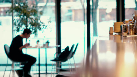 Defocused visitor and waiters in a modern cafe. 4K video Live Action