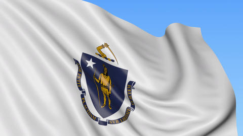 Waving flag of Massachusetts state against blue sky Footage