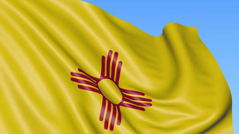 Waving flag of New Mexico state against blue sky Footage