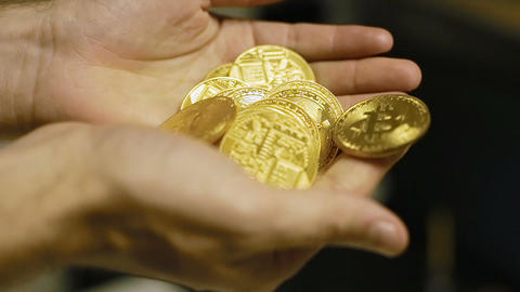 Slow Motion Person Holds Coins Made by Bitcoin Payment System Footage