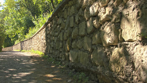 A stone wall along the old road Image