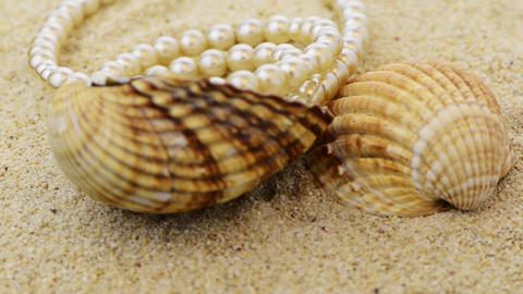 Pearls necklace on sand Footage