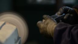 Man polishes aluminum Stock Video Footage