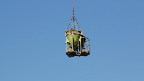 Cement container and worker are lifted on construction sites Stock Video Footage