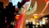Shopping Mall At Christmas Time - Customers Go Up The Escalator stock footage