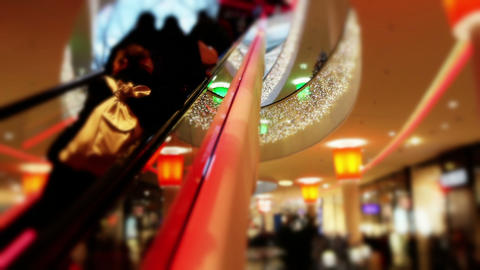 Shopping mall at Christmas time - customers go up the escalator Live Action