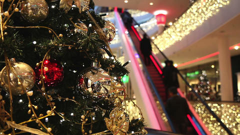 Shopping mall at Christmas time - customers go up the... Stock Video Footage