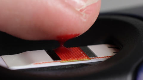 Blood drop on a test strip Stock Video Footage