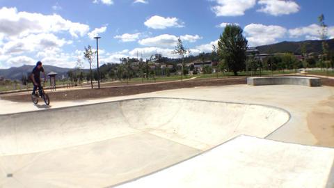 BMX bike stunt in skateboard park Stock Video Footage