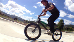 BMX bike stunt in skateboard park Stock Video Footage