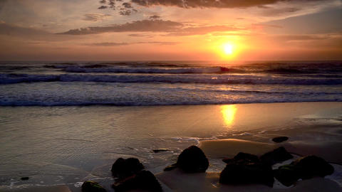 Sunset timelapse with waves crash on shore Stock Video Footage