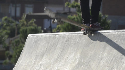 Skateboarders dropping a ramp Stock Video Footage