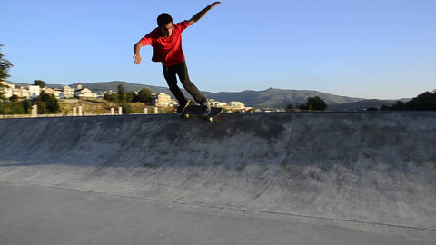 Skateboarder grinding a curb Stock Video Footage