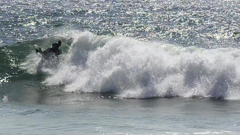 Body boarder riding a big wave Stock Video Footage