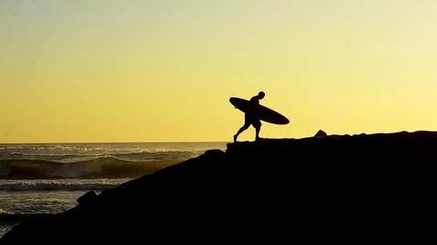 Surfer at sunset Stock Video Footage