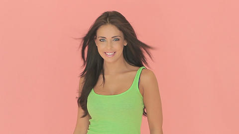 Beautiful smiling woman in green summer top Stock Video Footage