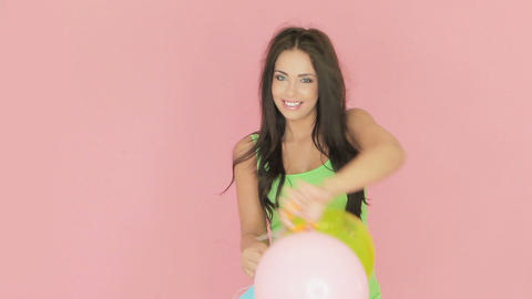 Beautiful woman playing with party balloons Stock Video Footage