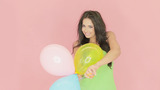 Beautiful Woman Playing With Party Balloons stock footage