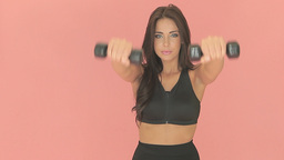 Beautiful woman working out with weights Stock Video Footage