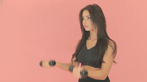 Athletic woman using dumbbells Footage